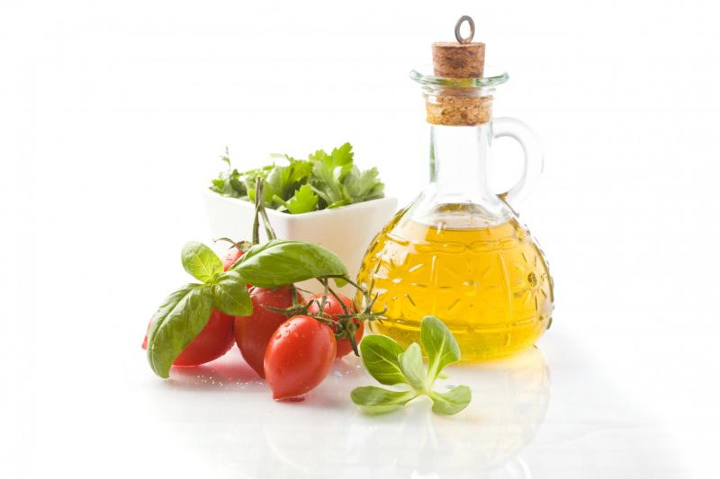 Olive oil, tomatoes and fresh herbs